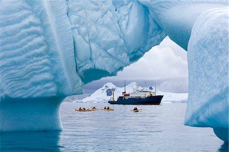 Kayakers and Russian Expedition Ship Akademik Shokalskiy, Antarctic Ocean, Antarctica Stock Photo - Rights-Managed, Code: 700-03484601