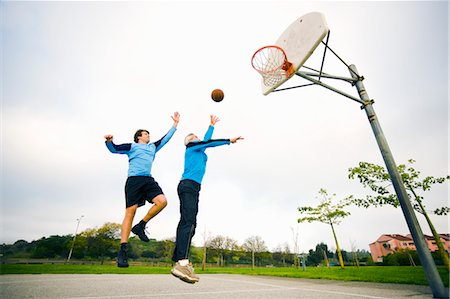 Father and Son Playing Basketball Stock Photo - Rights-Managed, Code: 700-03506304