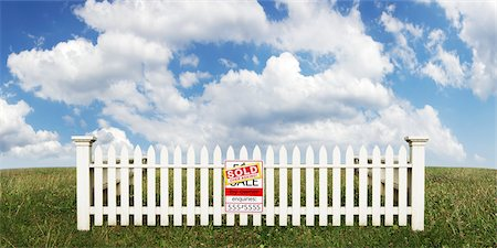 sold sign - White Picket Fence with Sold Sign in Open Field Stock Photo - Rights-Managed, Code: 700-03508132