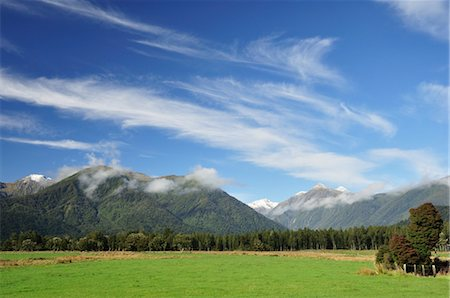 Farmland and Southern Alps, Jacobs River, West Coast, South Island, New Zealand Stock Photo - Rights-Managed, Code: 700-03508458
