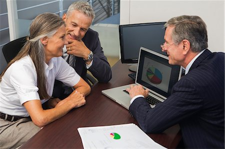 Mature Couple Talking with Financial Advisor Stock Photo - Rights-Managed, Code: 700-03501274