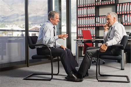 Two Businessmen Talking in Office Stock Photo - Rights-Managed, Code: 700-03501279