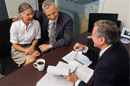Mature Couple Talking with Financial Advisor Stock Photo - Rights-Managed, Code: 700-03501272
