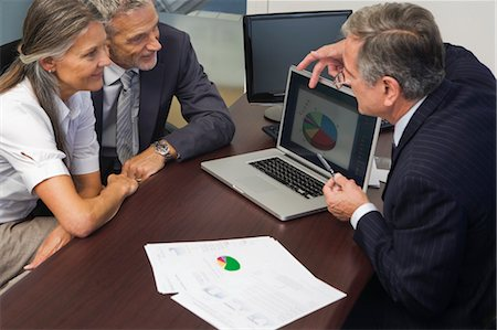 Mature Couple Talking with Financial Advisor Stock Photo - Rights-Managed, Code: 700-03501273