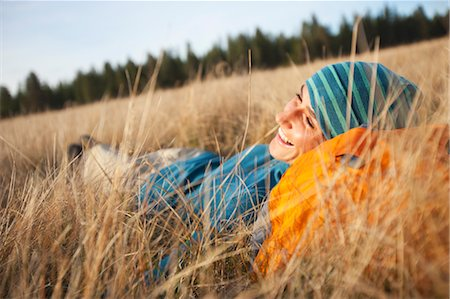 Woman Lying in Long Grass near Deschutes River, Oregon, USA Stock Photo - Rights-Managed, Code: 700-03502943