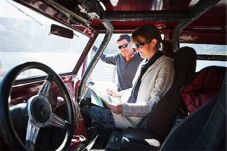 Couple Looking at Map in Vehicle, Lake Tahoe, California, USA Stock Photo - Rights-Managed, Code: 700-03503009