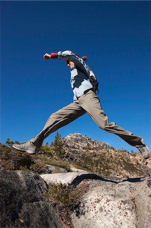 Woman Jumping from Rock to Rock at Donner Summit, near Lake Tahoe, California, USA Stock Photo - Rights-Managed, Code: 700-03503019