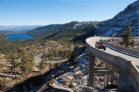 Vintage 4x4 Driving across Historic Bridge at Donner Summit, near Lake Tahoe, California, USA Stock Photo - Rights-Managed, Code: 700-03503027