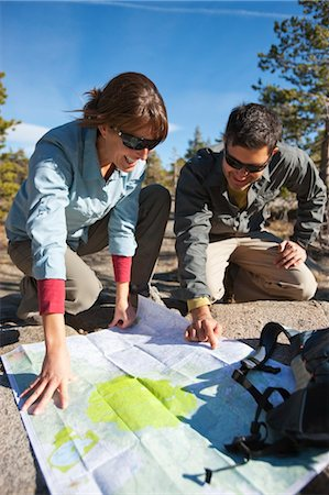 Couple Reading Trail Map while on Day Hike in High Sierra, near Lake Tahoe, California, USA Stock Photo - Rights-Managed, Code: 700-03503021