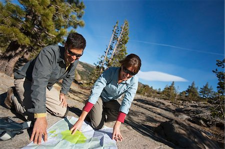 Couple Looking at Trail Map in High Sierra, near Lake Tahoe, California, USA Stock Photo - Rights-Managed, Code: 700-03503022