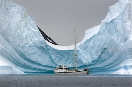 Yacht Anchored in Iceberg, Antarctica Stock Photo - Rights-Managed, Code: 700-03503166