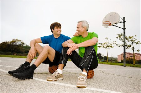 peter griffith - Father and Son Sitting on Basketballs on Court Stock Photo - Rights-Managed, Code: 700-03519160