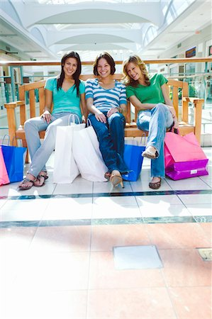 Three Women Sitting on Bench in Shopping Mall Stock Photo - Rights-Managed, Code: 700-03520320