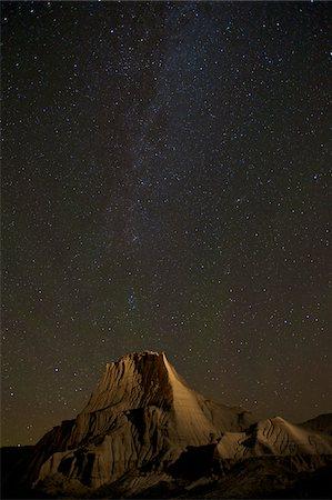 Milky Way over Dinosaur Provincial Park, Alberta, Canada Stock Photo - Rights-Managed, Code: 700-03554407