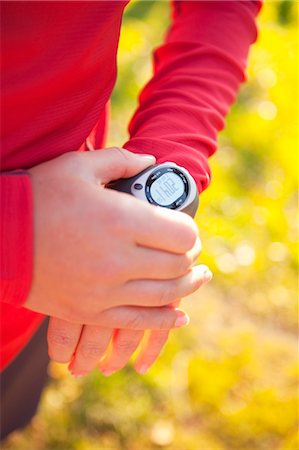 stop watch - Woman Setting Timer on Watch Stock Photo - Rights-Managed, Code: 700-03554438
