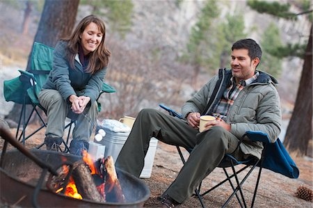 Couple Roasting Marshmellows while Camping, Truckee, California, USA Stock Photo - Rights-Managed, Code: 700-03554430