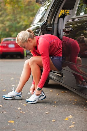 Woman Lacing Shoes, Green Lake Park, Seattle, Washington, USA Stock Photo - Rights-Managed, Code: 700-03554454