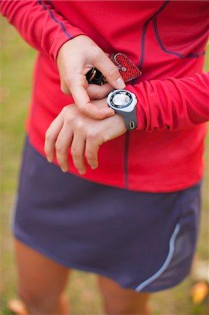 stop watch - Woman Setting Timer on Watch, Seattle, Washington, USA Stock Photo - Rights-Managed, Code: 700-03554457