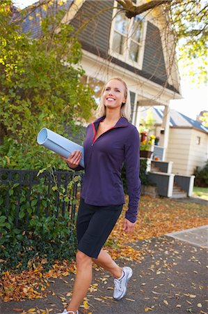 Woman carrying Yoga Mat, Seattle, Washington, USA Stock Photo - Rights-Managed, Code: 700-03554467