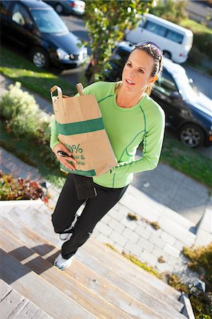 Woman Carrying Bag of Groceries up Front Steps, Seattle, Washington, USA Stock Photo - Rights-Managed, Code: 700-03554470