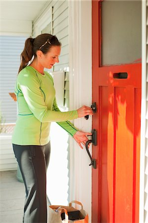 Woman with Groceries Unlocking Front Door, Seattle, Washington, USA Stock Photo - Rights-Managed, Code: 700-03554471
