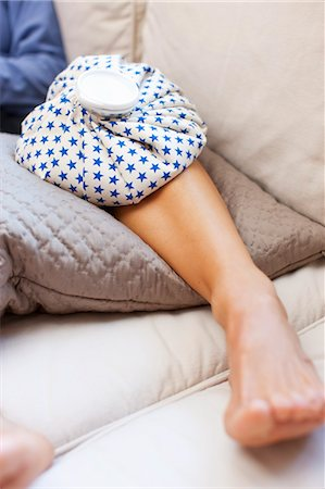 Woman with Ice Pack on Knee Stock Photo - Rights-Managed, Code: 700-03554516