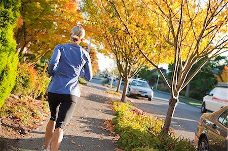 Woman Running on Sidewalk in Autumn, Seattle, Washington, USA Stock Photo - Rights-Managed, Code: 700-03554518