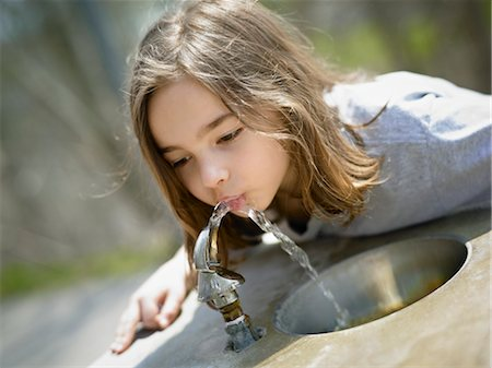 Girl Drinking Water from Drinking Fountain Stock Photo - Rights-Managed, Code: 700-03556895