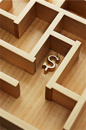 Golden Dollar Sign in Wooden Maze Stock Photo - Rights-Managed, Code: 700-03553415