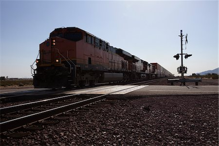 Freight Train at Railway Crossing, Eastern California, USA Stock Photo - Rights-Managed, Code: 700-03567774