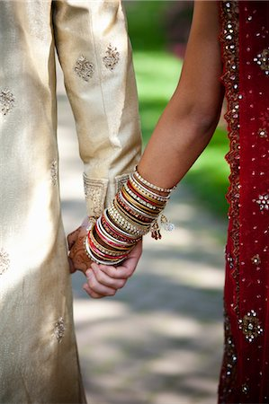 Close-up of Bride and Groom Holding Hands Stock Photo - Rights-Managed, Code: 700-03567855