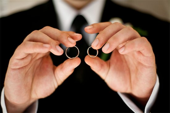 Groom Holding Wedding Rings Stock Photo - Premium Rights-Managed, Artist: Ikonica, Image code: 700-03567850