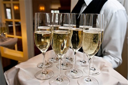 Waiter Holding Tray of Champagne Stock Photo - Rights-Managed, Code: 700-03567852