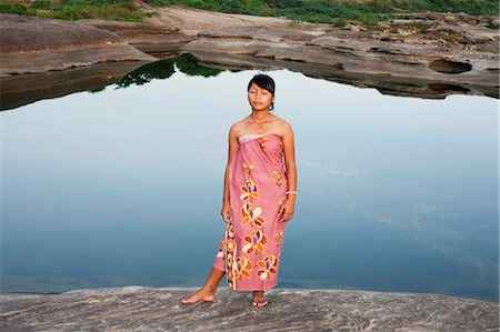 southeast asian - Girl Standing by Pond, SamPanBok, Ubon Ratchathani Province, Thailand Stock Photo - Rights-Managed, Code: 700-03567864