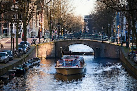 Tour Boat on Reguliersgracht Canal, Amsterdam, Netherlands Stock Photo - Rights-Managed, Code: 700-03573871
