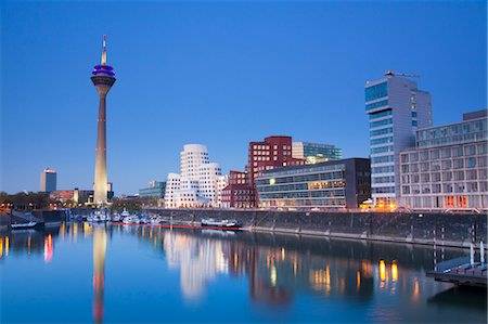 Rheinturm TV Tower and Neuer Zollhof Building at Dusk, Media Harbour, Dusseldorf, Germany Stock Photo - Rights-Managed, Code: 700-03573883