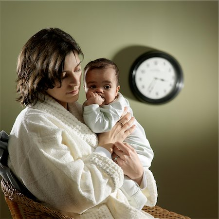 Tired Mother With Baby in the Middle of the Night Stock Photo - Rights-Managed, Code: 700-03586282