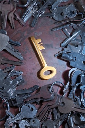 Golden Key in the Middle of a Pile of Assorted Keys Stock Photo - Rights-Managed, Code: 700-03586628