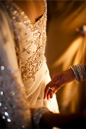 Hands Pinning Bride's Dress Stock Photo - Rights-Managed, Code: 700-03587180
