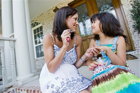 Mother Painting Daughter's Finger Nails Stock Photo - Rights-Managed, Code: 700-03596271