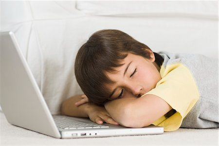 Boy Sleeping on Laptop Computer Stock Photo - Rights-Managed, Code: 700-03596282