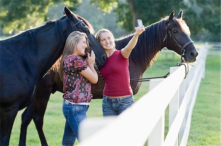 equestrian - Teenage Girls Taking Pictures of Themselves With Horses Stock Photo - Rights-Managed, Code: 700-03596308