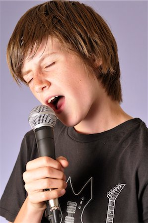 preteen open mouth - Boy Singing into Microphone Stock Photo - Rights-Managed, Code: 700-03601357