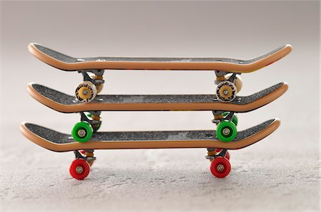 Three Toy Skateboards Stacked Stock Photo - Rights-Managed, Code: 700-03601510