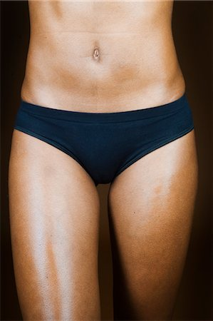Close-up of Woman in Her Underwear Stock Photo - Rights-Managed, Code: 700-03615461
