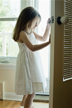 Girl in Doorway Stock Photo - Rights-Managed, Code: 700-03615566