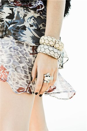 ring hand woman - Close-up of Woman Wearing Rings, Bracelets and Dress Stock Photo - Rights-Managed, Code: 700-03615572