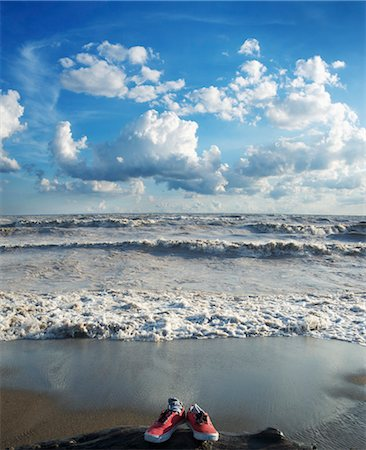 Sneakers on Beach with Rough Water Stock Photo - Rights-Managed, Code: 700-03615586