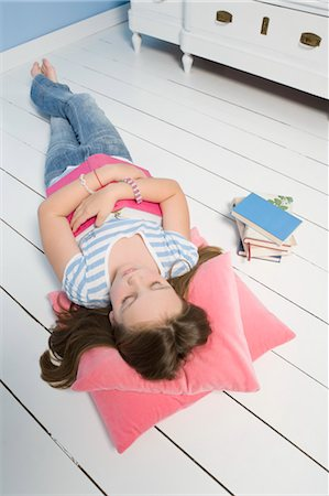 preteen girl - Girl Napping on Floor Stock Photo - Rights-Managed, Code: 700-03615826