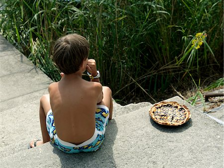 Little Boy With Cake, Province of La Spezia, Liguria, Italy Stock Photo - Rights-Managed, Code: 700-03615915